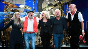 FILe - In this Jan. 26, 2018 file photo, Fleetwood Mac band members, from left, Stevie Nicks, John McVie, Christine McVie, Lindsey Buckingham and Mick Fleetwood appear at the 2018 MusiCares Person of the Year tribute honoring Fleetwood Mac in New York. T (Photo by Evan Agostini/Invision/AP, File)