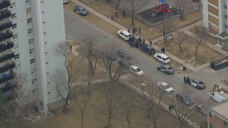 Police and volunteers search outside a Scarborough high-rise on Apr. 10, 2018, (Chopper 24)