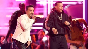 """In this Jan. 28, 2018 file photo, Luis Fonsi, left, and Daddy Yankee perform """"Despacito"""" at the 60th annual Grammy Awards in New York. ' """"Despacito'"""" and other popular music videos were the target of a security breach on the video sharing service Vevo. (Photo by Matt Sayles/Invision/AP, File)"""