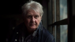 Musician Tom Cochrane poses in Toronto on Friday, February 6, 2015. THE CANADIAN PRESS/Darren Calabrese