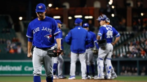 Toronto Blue Jays starting pitcher Marco Estrada walks off the field after being relieved in the fifth inning of a baseball game against the Baltimore Orioles, Wednesday, April 11, 2018, in Baltimore. (AP Photo/Patrick Semansky)
