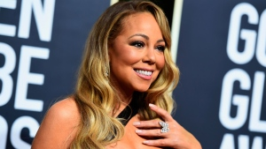 In this Jan. 7, 2018, file photo, Mariah Carey arrives at the 75th annual Golden Globe Awards at the Beverly Hilton Hotel in Beverly Hills, Calif. (Photo by Jordan Strauss/Invision/AP, File)
