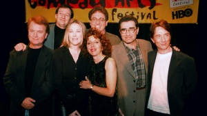 Former cast members of SCTV reunited at the U S Comedy Arts Festival Saturday night, March 6, 1999, in Aspen, Colo. From left front row are: Dave Thomas; Catherine O'Hara; Andrea Martin; Eugene Levy; and Martin Short. In the back row are Joe Flaherty, left, and Harold Ramis. (AP Photo/E Pablo Kosmicki)
