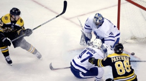 Boston Bruins left wing Brad Marchand (63) scores against Toronto Maple Leafs goaltender Frederik Andersen (31) as Maple Leafs center Leo Komarov (47) defends against Bruins right wing David Pastrnak (88) during the first period of Game 1 of an NHL hockey first-round playoff series Thursday, April 12, 2018, in Boston. (AP Photo/Elise Amendola)
