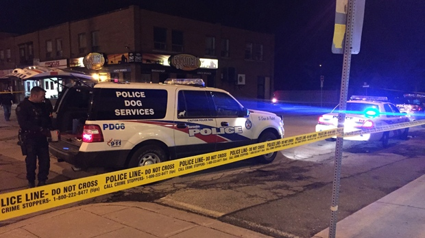 Police are seen on Bloor Street West after a man was shot on April 13, 2018. (Michael Nguyen/CP24)