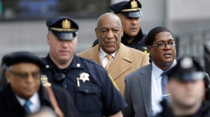 Bill Cosby, center, leaves his sexual assault trial for the day, Thursday, April 12, 2018, at the Montgomery County Courthouse in Norristown, Pa. (AP Photo/Matt Slocum)