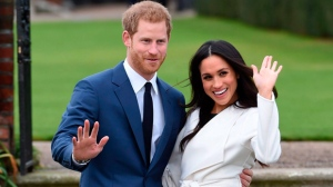 In this Nov. 27, 2017 file photo, engaged couple Britain's Prince Harry, left, and Meghan Markle pose for the media at Kensington Palace in London. The royal nuptials will take place on Saturday, May 19. (Eddie Mulholland/Pool via AP)