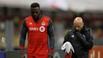Toronto FC's Jozy Altidore, left, leaves the field as he is replaced by Tosaint Ricketts during the second leg of a CONCACAF Champions League soccer semifinal against America in Mexico City, Tuesday, April 10, 2018. Toronto FC had its big guns in the lineup for its two-leg round of 16 CONCACAF Champions League matchup against the Colorado Rapids last February.The roster will look significantly different on Saturday afternoon at Dick's Sporting Goods Park. THE CANADIAN PRESS/AP/Eduardo Verdugo