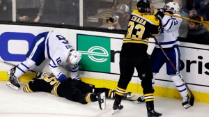 In this April 12, 2018, file photo, Boston Bruins defenseman Zdeno Chara (33) shoves Toronto Maple Leafs center Nazem Kadri (43) to retaliate for his late hit on Boston Bruins center Tommy Wingels (57), bottom left, as Maple Leafs center Mitchell Marner (16) starts to get up during the third period of Game 1 of an NHL hockey first-round playoff series, in Boston. Through the first two days of the Stanley Cup playoffs, there have already been a handful of hits to the head, two ejections, one suspension and the possibility of more to come. (AP Photo/Elise Amendola)