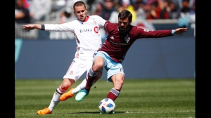 Toronto FC midfielder Ager Aketxe, left, fights for control of the ball with Colorado Rapids midfielder Jack Price in the second half of an MLS soccer match Saturday, April 14, 2018, in Commerce City, Colo. The Rapids won 2-0. (AP Photo/David Zalubowski)