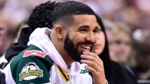 Rapper Drake, watches first half round one NBA playoff basketball action between the Toronto Raptors and Washington Wizards in Toronto on Saturday, April 14, 2018. THE CANADIAN PRESS/Frank Gunn