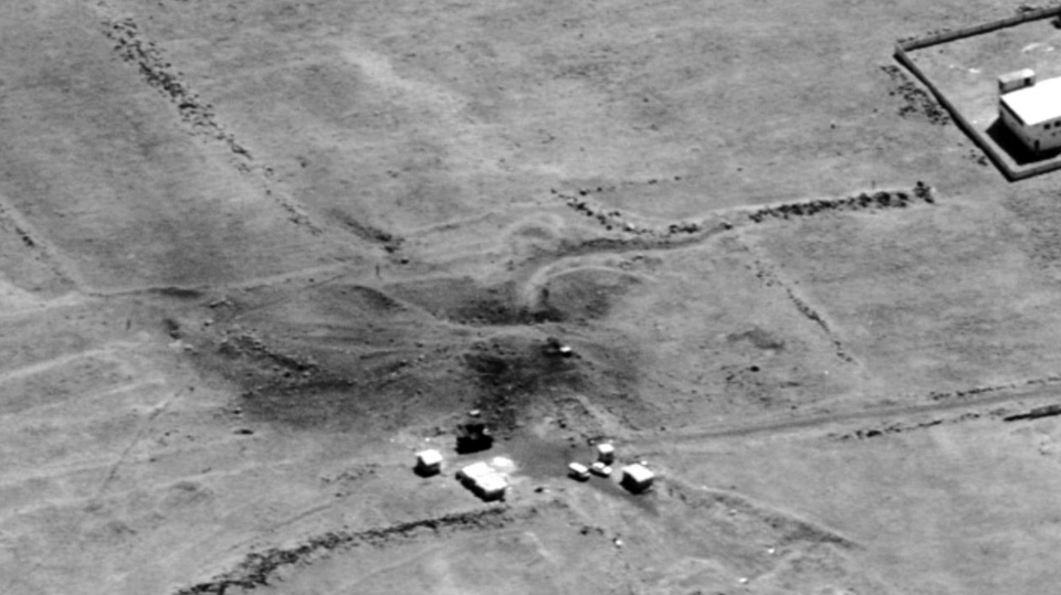 This image provided by the Department of Defense was presented as part of a briefing slide at the Pentagon briefing on Saturday, April 14, 2018, and shows a photo of a preliminary damage assessment from the Him Shinshar Chemical Weapons Bunker in Syria that was struck by missiles from the U.S.-led coalition in response to Syria's use of chemical weapons on April 7. (Department of Defense via AP)