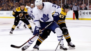Toronto Maple Leafs' Kasperi Kapanen tries to hold off Boston Bruins defenseman Torey Krug during the first period of Game 2 of an NHL hockey first-round playoff series in Boston, Saturday, April 14, 2018. (AP Photo/Winslow Townson)