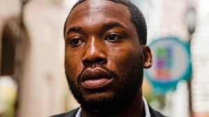 In this Nov. 6, 2017, file photo, rapper Meek Mill arrives at the Criminal Justice Center in Philadelphia. During a Monday, April 16, 2018, court hearing, Philadelphia prosecutors said Mill's drug and gun convictions should be thrown out and he should be granted a new trial, but Judge Genece Brinkley declined to rule and scheduled another hearing for June 2018. (AP Photo/Matt Rourke, File)