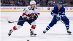 Toronto Maple Leafs centre Leo Komarov (47) defends against Florida Panthers centre Denis Malgin (62) during third period NHL action, in Toronto, on Tuesday, February 20, 2018. THE CANADIAN PRESS/Christopher Katsarov