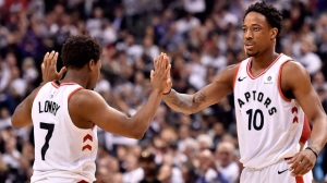Toronto Raptors guard Kyle Lowry (7) and teammate DeMar DeRozan (10) celebrate a basket during first half NBA basketball action against the Washington Wizards, in Toronto on Tuesday, April 17, 2018. THE CANADIAN PRESS/Nathan Denette