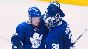 Toronto Maple Leafs centre Auston Matthews (34) celebrates with Maple Leafs goaltender Frederik Andersen (31) after defeating the Boston Bruins in NHL round one playoff hockey action in Toronto on Monday, April 16, 2018. THE CANADIAN PRESS/Nathan Denette