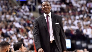 Toronto Raptors coach Dwane Casey smiles during his 61st birthday during second half NBA basketball action against the Washington Wizards, in Toronto on Tuesday, April 17, 2018. THE CANADIAN PRESS/Nathan Denette