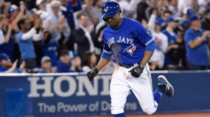 Toronto Blue Jays designated hitter Curtis Granderson (18) rounds the bases after hitting a grand slam off of Kansas City Royals relief pitcher Justin Grimm during eighth inning AL baseball action in Toronto on Wednesday, April 18, 2018. Jays centre fielder Kevin Pillar (11), shortstop Aledmys Diaz (1) and catcher Luke Maile (21) scored on the play. THE CANADIAN PRESS/Nathan Denette