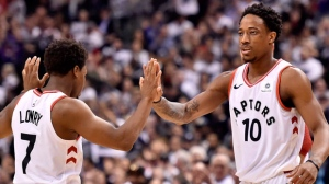 "Toronto Raptors guard Kyle Lowry (7) and teammate DeMar DeRozan (10) celebrate a basket during first half NBA basketball action against the Washington Wizards, in Toronto on Tuesday, April 17, 2018. Dwane Casey remembers the ""pow-wow"" he had with DeMar DeRozan and Kyle Lowry. THE CANADIAN PRESS/Nathan Denette"