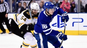 Toronto Maple Leafs centre Mitchell Marner (16) takes a shot but doesn't score on a breakaway as Boston Bruins defenceman Adam McQuaid (54) tries to chase him down during second period NHL round one playoff hockey action in Toronto on Thursday, April 19, 2018. THE CANADIAN PRESS/Nathan Denette