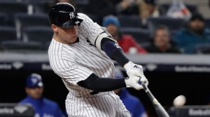 New York Yankees' Aaron Judge connects for a solo home run against the Toronto Blue Jays during the seventh inning of a baseball game Thursday, April 19, 2018, in New York. (AP Photo/Julie Jacobson)