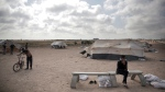 Palestinian protesters set up tents at the Gaza Strip's border with Israel, Thursday, April 19, 2018. Palestinian activists are moving protest encampments closer to Israel's fence ahead of mass demonstration. (AP Photo/ Khalil Hamra)