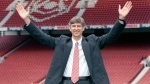 In this Sept. 22, 1996 file photo new Arsenal manager Arsene Wenger gestures following a press conference at Highbury Stadium, London. Arsenal manager Arsene Wenger says he will leave the English club at the end of the season after more than 21 years in charge. (Dave Cheskin/PA via AP)