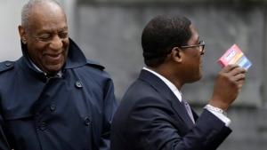 Bill Cosby, left, smiles as his spokesman Andrew Wyatt displays a package of Benadryl tablets to the media after Cosby's sexual assault retrial, Thursday, April 19, 2018, at the Montgomery County Courthouse in Norristown, Pa. Cosby's chief accuser could have been made woozy either by the cold and allergy medicine Benadryl or by quaaludes, an expert testified Thursday as the prosecution rested in the comedian's sexual assault retrial. (AP Photo/Matt Slocum)