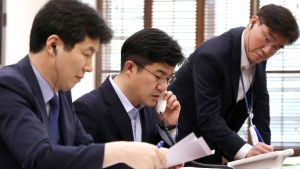 In this photo provided by South Korea Presidential Blue House via Yonhap News Agency, an official from South Korean President Blue House talks on the phone with North Korea side for a hotline test at the presidential Blue House in Seoul, South Korea, Friday, April 20, 2018. (South Korea Presidential Blue House/Yonhap via A