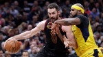Cleveland Cavaliers' Kevin Love, left, drives against Indiana Pacers' Trevor Booker during the first half of Game 2 of an NBA basketball first-round playoff series Wednesday, April 18, 2018, in Cleveland. (AP Photo/Tony Dejak)
