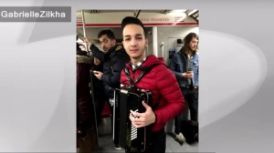 "A man is seen playing ""Despacito"" on a TTC subway train in this undated photo. (@GabrielleZilkha/Twitter)"