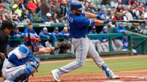 Toronto Blue Jays' Kendrys Morales (8) follows through on his three-run home run in front of Texas Rangers catcher Robinson Chirinos, left, during the first inning of a baseball game, Sunday, April 8, 2018, in Arlington, Texas. (AP Photo/Jim Cowsert)