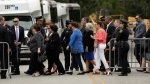 People arrive at St. Martin's Episcopal Church for the visitation of former first lady Barbara Bush Friday, April 20, 2018, in Houston. Barbara Bush died on April 17, at the age of 92. (AP Photo/Evan Vucci)