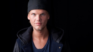 In this Aug. 30, 2013 file photo, Swedish DJ-producer, Avicii poses for a portrait in New York. Swedish-born Avicii, whose name is Tim Bergling, was found dead, Friday April 20, 2018, in Muscat, Oman. He was 28. (Photo by Amy Sussman/Invision/AP, File)