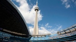 The CN Tower looms over the Toronto Blue Jays and Detroit Tigers in this file photo. THE CANADIAN PRESS/Darren Calabrese