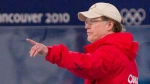 National team coach Michael Crowe is seen during a delay in competition at the men's 500m long-track speed skating event at the XXI Olympic Winter Games in Richmond, B.C., on Monday Feb.15, 2010. THE CANADIAN PRESS/Adrian Wyld