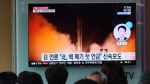 People watch a TV screen showing a file footage of North Korea's missile launch during a news program at the Seoul Railway Station in Seoul, South Korea, Saturday, April 21, 2018.  (AP Photo/Ahn Young-joon)