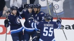 Winnipeg Jets' Andrew Copp (9), Joel Armia (40), Dustin Byfuglien (33) and Mark Scheifele (55) celebrate Armia's goal against the Minnesota Wild during first period game five NHL playoff action in Winnipeg on Friday, April 20, 2018. THE CANADIAN PRESS/John Woods