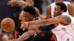 Toronto Raptors forward OG Anunoby, left, battles for the ball against Washington Wizards guard John Wall, right, during the first half of Game 3 of an NBA basketball first-round playoff series, Friday, April 20, 2018, in Washington. (AP Photo/Nick Wass)