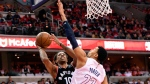 Toronto Raptors guard DeMar DeRozan (10) goes to the basket against Washington Wizards forward Otto Porter Jr. (22) during the first half of Game 3 of an NBA basketball first-round playoff series, Friday, April 20, 2018, in Washington. (AP Photo/Nick Wass)