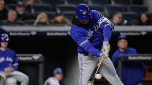 Toronto Blue Jays' Lourdes Gurriel Jr. connects for a two-run base hit against the New York Yankees during the fourth inning of a baseball game, Friday, April 20, 2018, in New York. (AP Photo/Julie Jacobson)