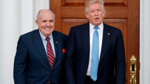 In this Nov. 20, 2016, file photo, then-President-elect Donald Trump, right, and former New York Mayor Rudy Giuliani pose for photographs as Giuliani arrives at the Trump National Golf Club Bedminster clubhouse in Bedminster, N.J. Giuliani is joining the legal team defending President Donald Trump in the special counsel's Russia investigation. That's according to a statement from Trump personal attorney Jay Sekulow. (AP Photo/Carolyn Kaster, File)