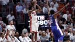 Miami Heat's Justise Winslow (20) attempts a 3-point basket as Philadelphia 76ers' Joel Embiid (21) defends during the first half of Game 3 of a first-round NBA basketball playoff series Thursday, April 19, 2018, in Miami. (AP Photo/Lynne Sladky)