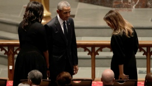 Former President Barack Obama and former first lady Michelle Obama greet first lady Melania Trump at St. Martin's Episcopal Church for a funeral service for former first lady Barbara Bush, Saturday, April 21, 2018, in Houston. (AP Photo/David J. Phillip )