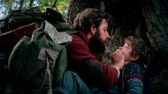 "This image released by Paramount Pictures shows John Krasinski, left, and Noah Jupe in a scene from ""A Quiet Place."" (Jonny Cournoyer/Paramount Pictures via AP)"