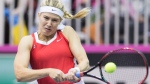 Eugenie Bouchard of Canada returns to Lesia Tsurenko of Ukraine during their Fed Cup tennis match in Montreal, Sunday, April 22, 2018. THE CANADIAN PRESS/Graham Hughes
