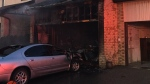 A sedan is seen badly damaged by fire at a townhome in Mississauga on April 22, 2018. (Peel EMS)