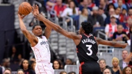 Washington Wizards guard Bradley Beal (3) looks to pass the ball against Toronto Raptors forward OG Anunoby (3) during the first half of Game 4 of an NBA basketball first-round playoff series, Sunday, April 22, 2018, in Washington. (AP Photo/Nick Wass)