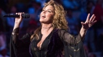 Shania Twain performs at the opening night ceremony of the U.S. Open tennis tournament at the USTA Billie Jean King National Tennis Center on Monday, Aug. 28, 2017, in New York. Twain is apologizing after telling a British newspaper that she would have voted for U.S. President Donald Trump if she were eligible. THE CANADIAN PRESS/AP-Photo by Charles Sykes/Invision/AP